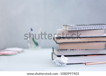 Anotebook(notepad, writing pad, drawing pad, legal pad) is a small book or binder of paper pages, often ruled, used for purposes such as recording notes #1080997403