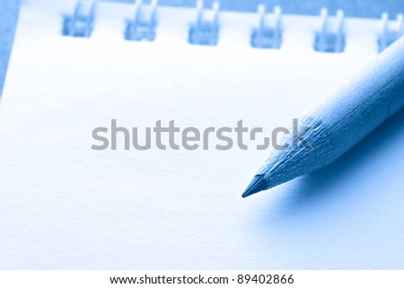 A notepad with a pencil