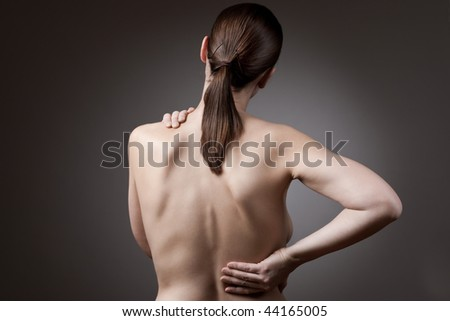 A nude back of a woman indicating back pain