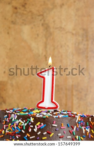 A number candle is lit in celebration of the first year.
