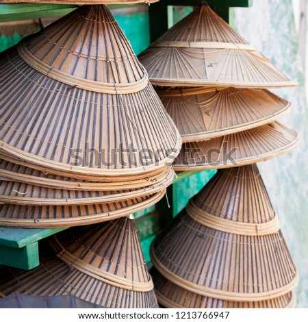 A number of Burmese conical bamboo hats on sale in a shop on a market in Nyaung-U in central Burma