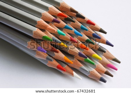 A number of colored pencils on white background