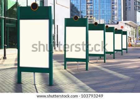 A number of empty stands for advertising billboards on the streets of modern cities. Sunrise light. With boards clipping patch