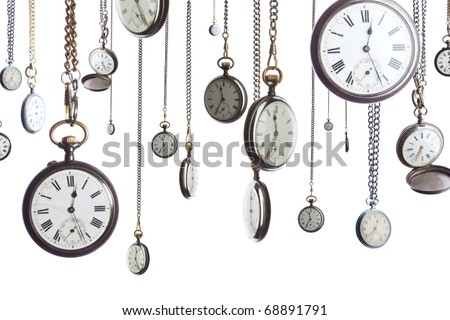 A number of pocket watches on chain isolated on white