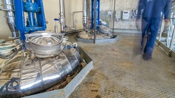 A number of steel tanks for mixing liquids timelapse . Stainless steel, industry. Operator near control panel