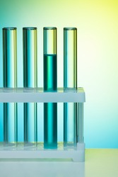 A number of test tubes on blue background in the lab