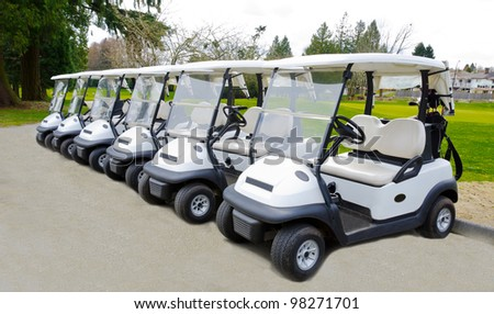 A number of the golf carts at the golf course