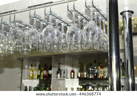 A number of washed glasses hung to dry in the bar.