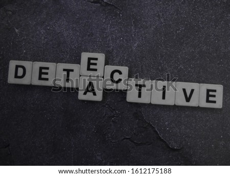 A number of words are combined; Detective, Detect, Active, word cube with background.
