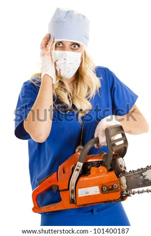 A nurse is holding a chain saw and she has blood on her.