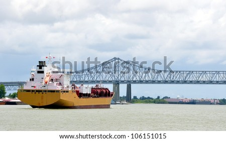 A Oil Tanker Freighter Ship Approaches The Greater New Orleans Mississippi River Bridge