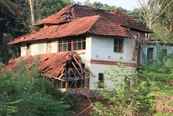 A old damaged traditional kerala style house in India