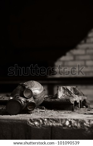 a old gas mask on a dirt concrete floor