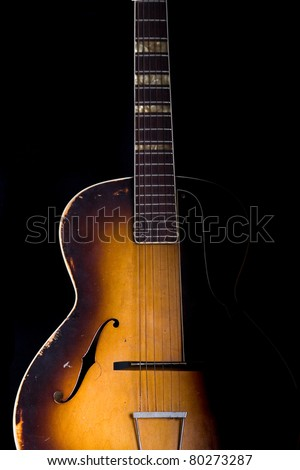 A old guitar - stock photo