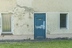 A old house with an door with german word for kitchen