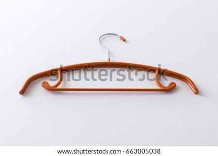 A orange hanger on the white background.