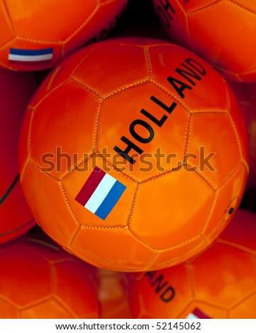 a orange soccerball with dutch flag