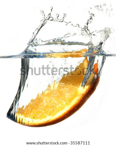 A orange splashing into water against a white background. Hi-speed shoot. EOS 1Ds mkII.