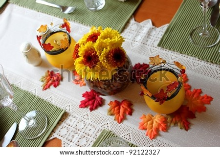A orange yellow autumn centerpiece for Thanksgiving
