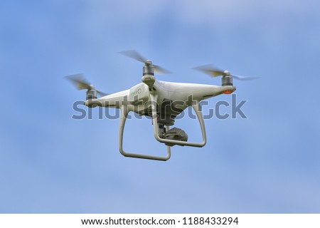 A outdoor photo of a flying drone