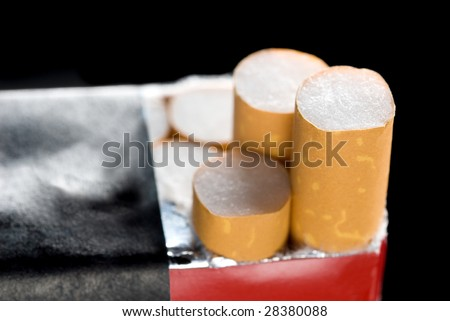 A pack of cigarettes isolated on a black background.