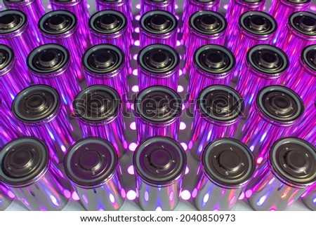 A pack of new modern high-capacity lithium-ion cells. A prototype of new batteries on a laboratory table with UV light. Zdjęcia stock ©