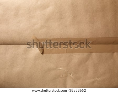 A packet  with a open tape.