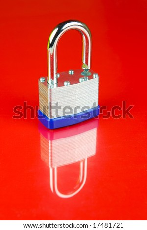 A padlock isolated against a red background