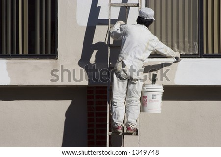 A painter applies a fresh coat of paint.