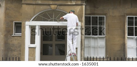 A painter works on property exterior.