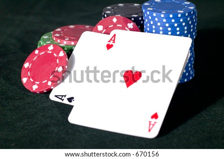 A pair of aces and a stack of chips
