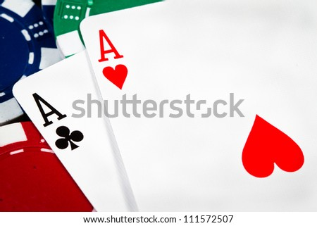 A pair of aces over poker chips - stock photo