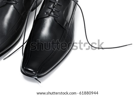 a pair of black leather shoes for man isolated
