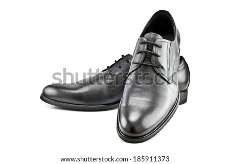 a pair of black men's classic shoes isolated on white background
