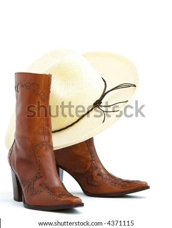 a pair of brown leather boots with a straw western hat