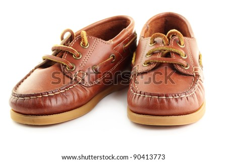 A pair of children's boat shoes or top-siders, isolated on a white background.