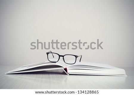 a pair of designer glasses on...