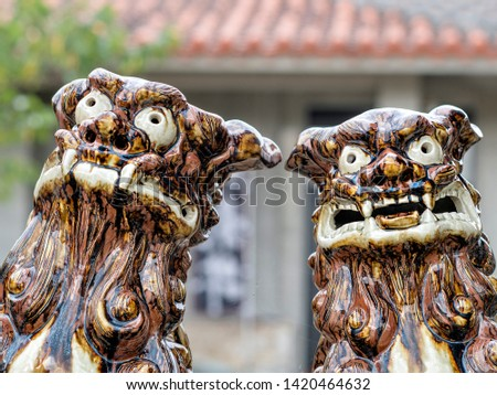 A pair of fierce looking male and female Lion Dogs guarding from evil spirits #1420464632
