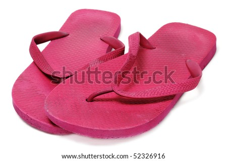 a pair of flip-flops floating isolated on a white background - stock photo
