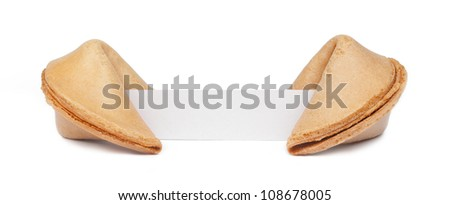 A pair of fortune cookies with a blank piece of paper isolated on white.