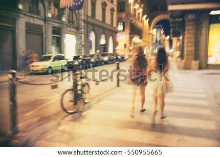 a pair of girls walking along...