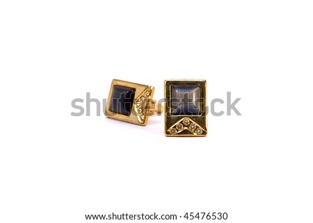 A pair of gold cufflinks  on a white background isolated