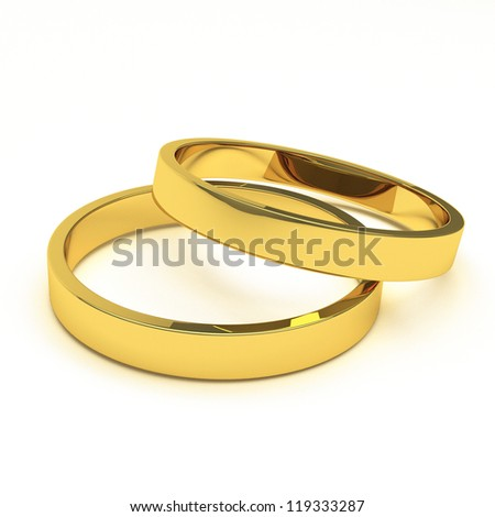 a pair of gold rings for marrriage or engagement concepts.