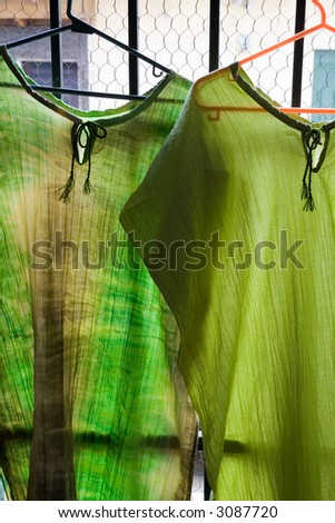 A pair of green dresses in an El Salvador souvenir shop
