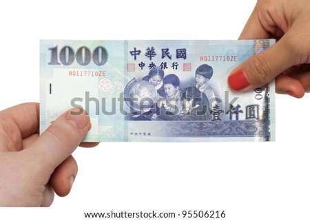 A pair of hands exchanging a 1000 New Taiwan dollar bill