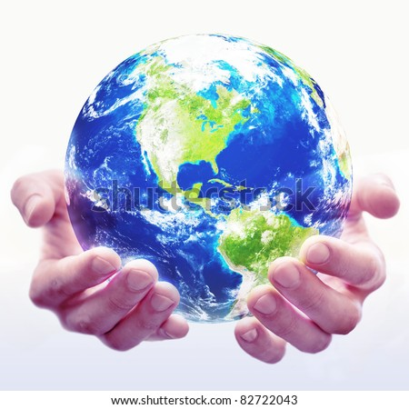 A pair of hands hold a globe with white background
