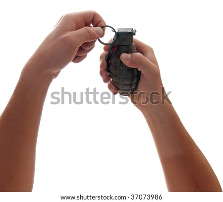 A pair of hands prepares to pull the pin on a grenade.