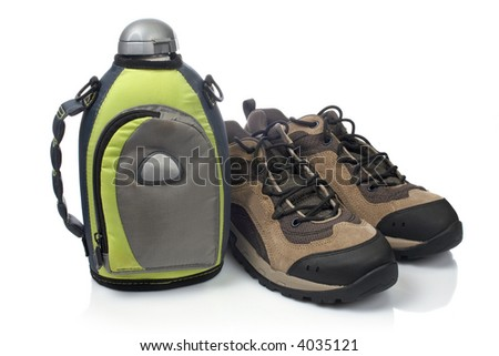 A pair of hiking boots and canteen with shadow, reflected on white background