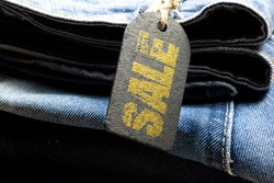 A pair of jeans and an indication of a sale