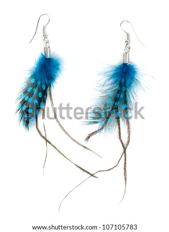A pair of ladies earrings from feather. Isolate on white